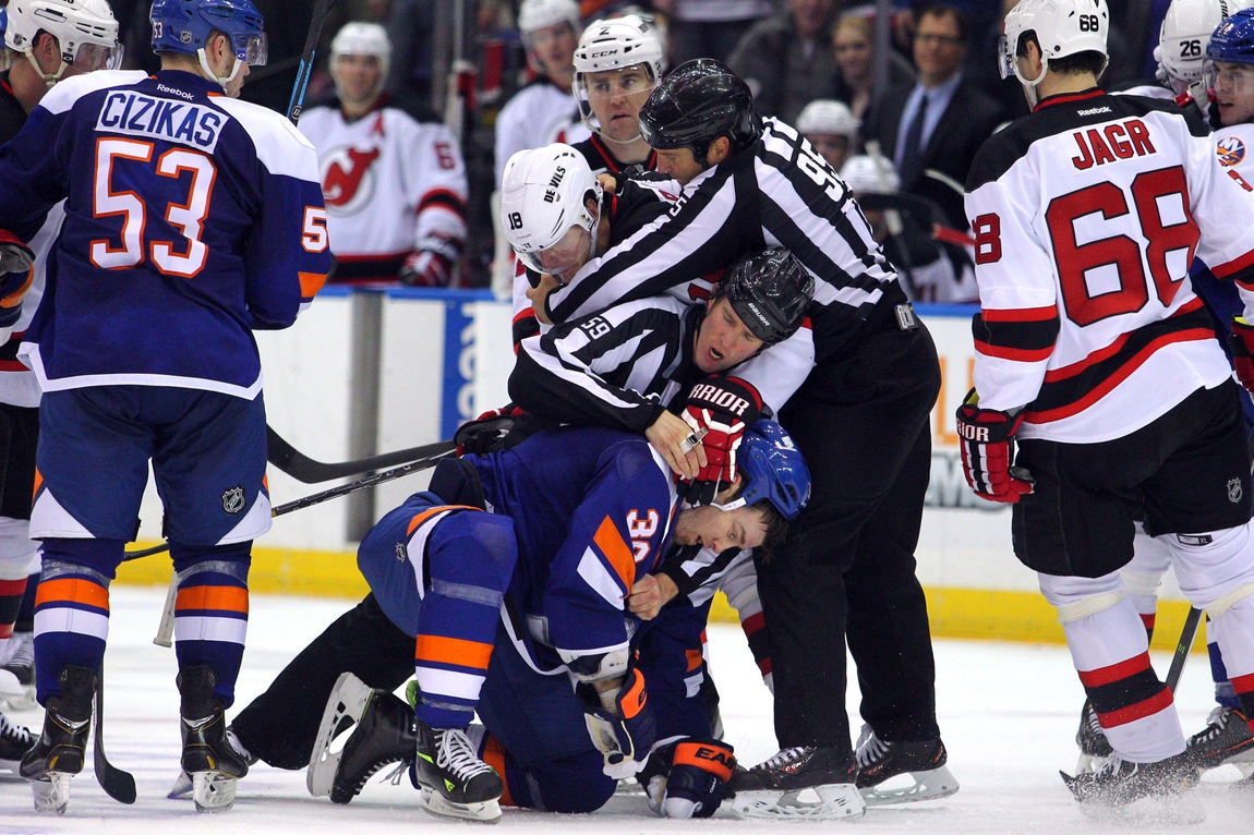 aad5d528a Mar 1, 2014; Uniondale, NY, USA; New Jersey Devils right wing Steve Bernier  (18) and New York Islanders left wing Eric Boulton (36) are separated by ...