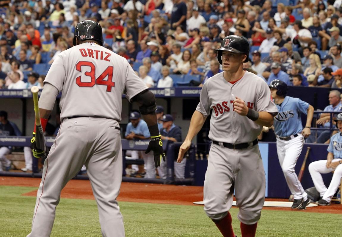 208fb0252 Aug 31, 2014; St. Petersburg, FL, USA; Boston Red Sox third baseman Brock  Holt (26) is congratulated by Boston Red Sox designated hitter David Ortiz  (34) ...