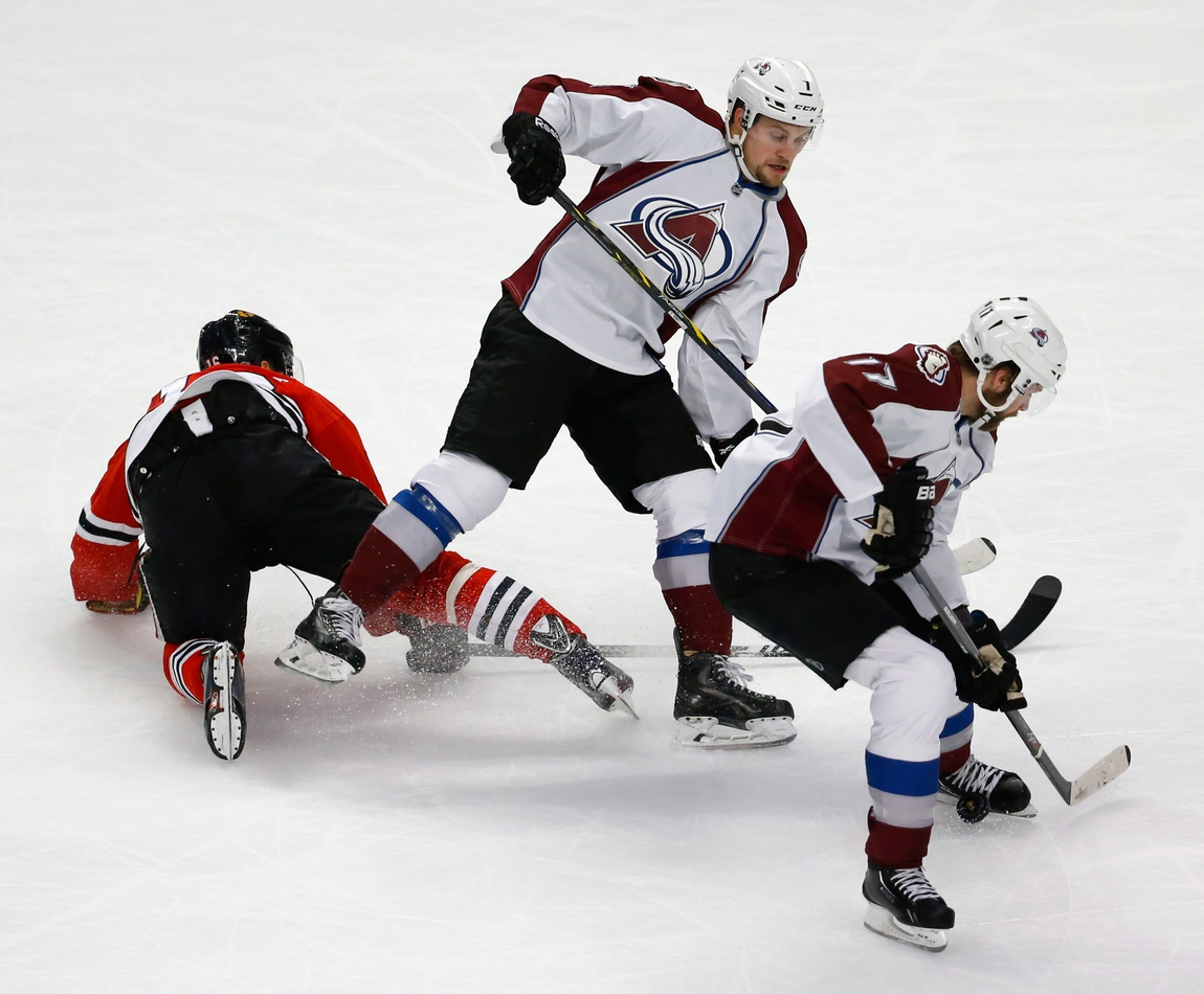 best website a959a 407f2 Jan 6, 2015  Chicago, IL, USA  Colorado Avalanche defenseman Brad Stuart  (17) tries to control the puck next to away from Chicago Blackhawks center  Marcus ...