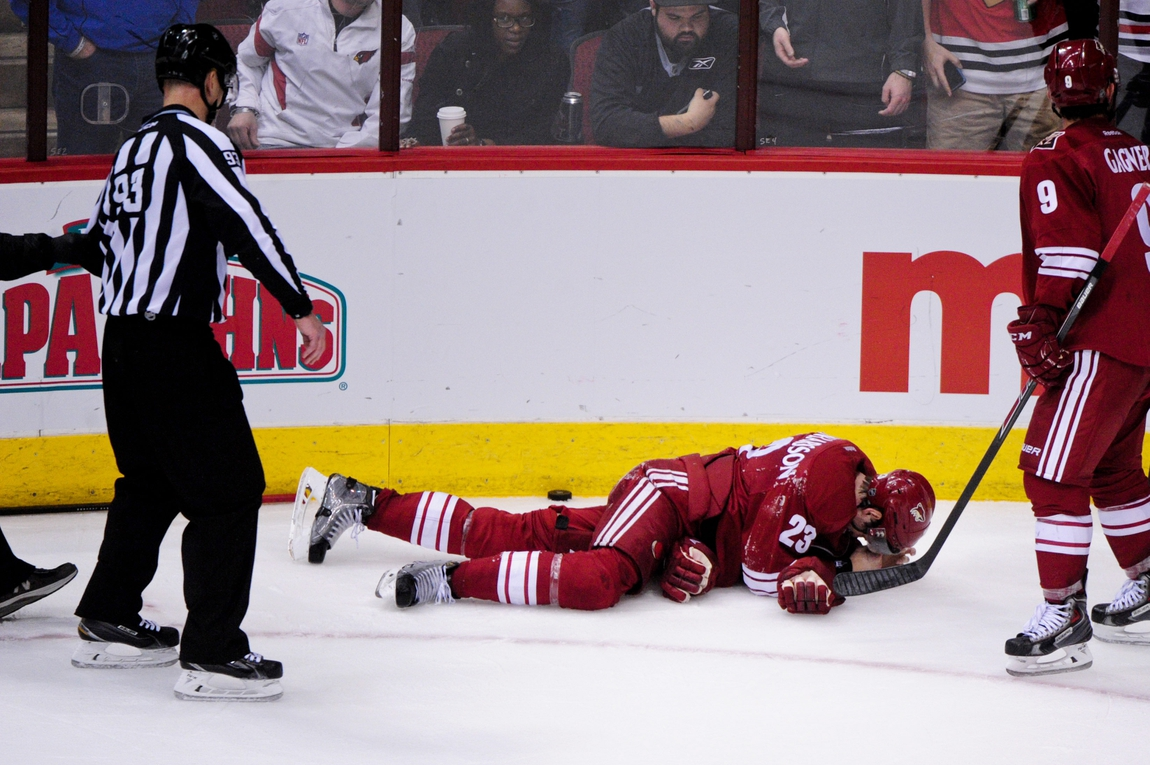 85496c1a9 ... defenseman Oliver Ekman-Larsson (23) lays on the ice as NHL linesman  Brian Murphy (93) looks on in the third period against the Chicago  Blackhawks ...