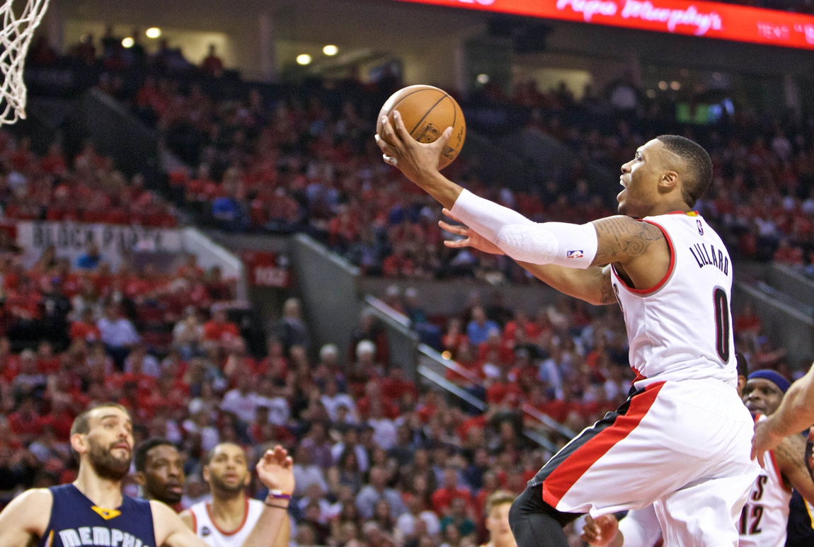 8c60d9f3b66 Apr 27, 2015; Portland, OR, USA; Portland Trail Blazers guard Damian Lillard  (0) shoots against the Memphis Grizzlies during the second quarter in game  four ...