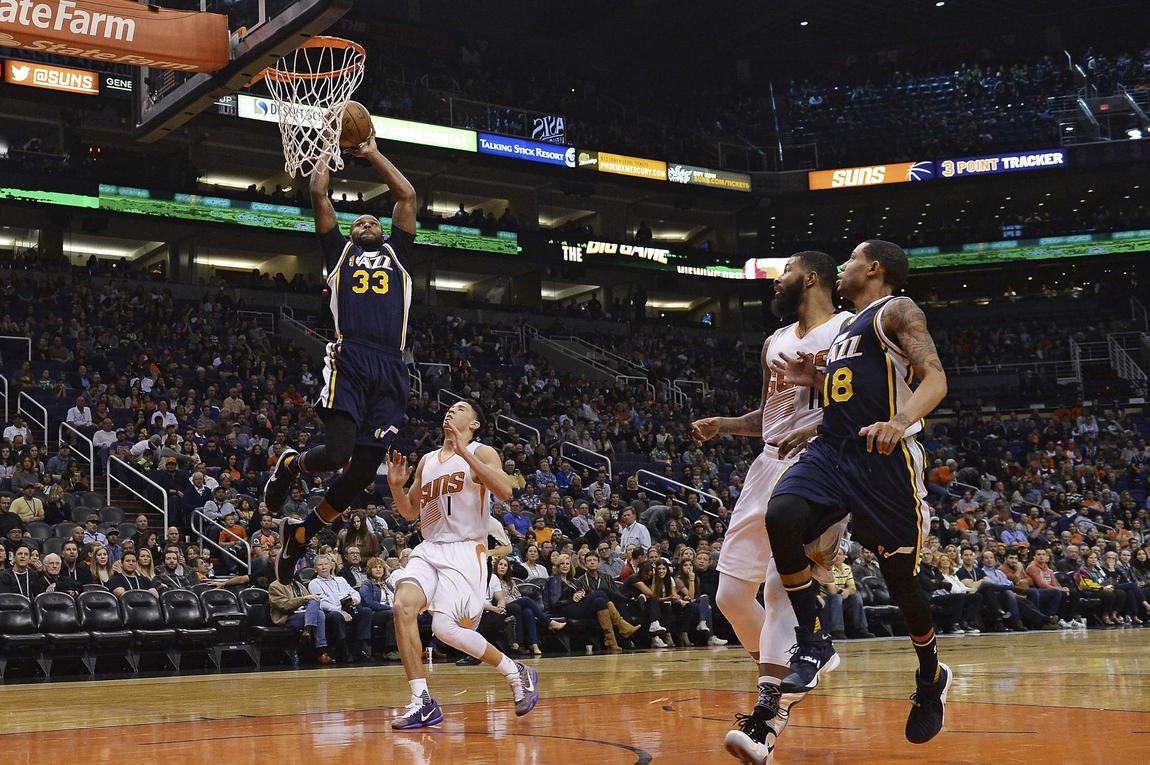 6835b9bb386 Feb 6, 2016; Phoenix, AZ, USA; Utah Jazz forward Trevor Booker (33) dunks  the ball in front of Phoenix Suns guard Devin Booker (1) at Talking Stick  Resort ...