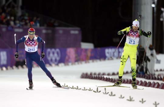 Feb 8, 2014; Krasnaya Polyana, RUSSIA; Ole Einar Bjoerndalen (NOR, left) and Matej Kazar (SVK, right) during the Sochi 2014 Olympic Winter Games at Laura Cross-Country Ski and Biathlon Center. Mandatory Credit: Jack Gruber-USA TODAY Sports