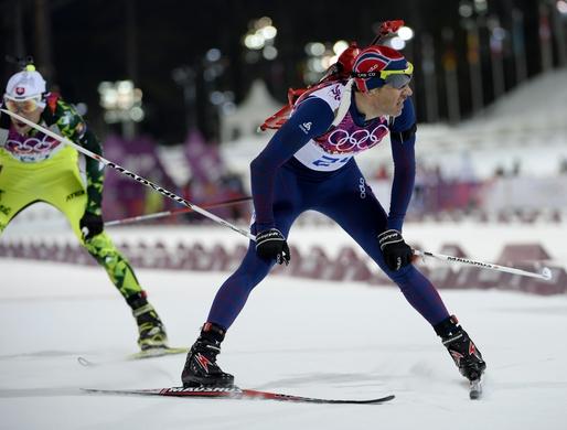 Feb 8, 2014; Krasnaya Polyana, RUSSIA; Ole Einar Bjoerndalen (NOR, foreground) and Matej Kazar (SVK, background) during the Sochi 2014 Olympic Winter Games at Laura Cross-Country Ski and Biathlon Center. Mandatory Credit: Jack Gruber-USA TODAY Sports