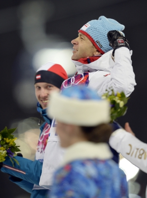 Feb 8, 2014; Krasnaya Polyana, RUSSIA; Ole Einar Bjoerndalen (NOR, right) and Dominik Landertinger (AUT, left) celebrate at the flower ceremony during the Sochi 2014 Olympic Winter Games at Laura Cross-Country Ski and Biathlon Center. Mandatory Credit: Jack Gruber-USA TODAY Sports