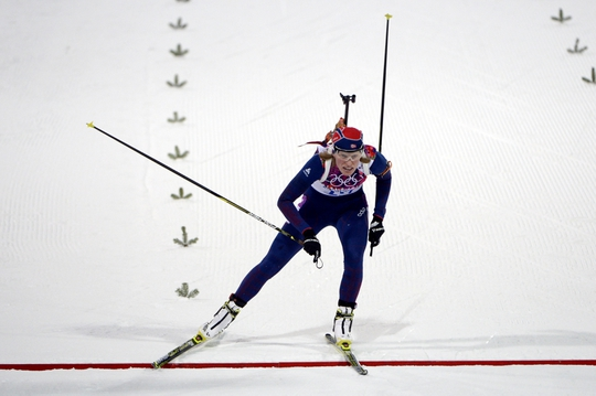 Feb 9, 2014; Krasnaya Polyana, RUSSIA; Tora Berger (NOR) crosses the finish line of the women's 7.5km sprint biathlon in the Sochi 2014 Olympic Winter Games at Laura Cross-Country Ski and Biathlon Center. Mandatory Credit: Eric Bolte-USA TODAY Sports