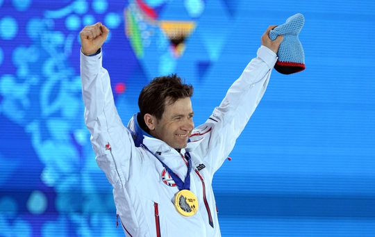Feb 9, 2014; Sochi, RUSSIA; Ole Einar Bjoerndalen (NOR) celebrates after receiving his gold medal in the medal ceremony for the men's 10km biathlon sprint during the Sochi 2014 Olympic Winter Games at Medals Plaza. Mandatory Credit: Kyle Terada-USA TODAY Sports