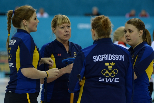 Feb 10, 2014; Sochi, RUSSIA; (L-R) Christina Bertrup (SWE) and Maria Prytz (SWE) and Margaretha Sigfridsson (SWE) and Maria Wennerstroem (SWE) in the women's curling round robin session 1 during the Sochi 2014 Olympic Winter Games at Ice Cube Curling Center. Mandatory Credit: Kyle Terada-USA TODAY Sports