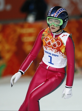 Feb 11, 2014; Krasnaya Polyana, RUSSIA; Sarah Hendrickson (USA) after landing a first round jump during Sochi 2014 Olympic Winter Games at RusSki Gorki Ski Jumping Center. Mandatory Credit: Rob Schumacher-USA TODAY Sports