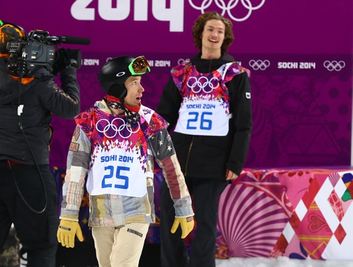 Feb 11, 2014; Krasnaya Polyana, RUSSIA; Shaun White (USA, left) looks back at the scoreboard as Iouri Podladtchikov (SUI, right) celebrates his win in the men's snowboarding halfpipe finals of the Sochi 2014 Olympic Winter Games at Rosa Khutor Extreme Park. Mandatory Credit: Guy Rhodes-USA TODAY Sports