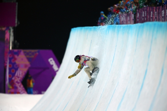 Feb 11, 2014; Krasnaya Polyana, RUSSIA; Shaun White (USA) slips on his final run in the mens snowboard half pipe final during the Sochi 2014 Olympic Winter Games at Rosa Khutor Extreme Park. Mandatory Credit: Guy Rhodes-USA TODAY Sports