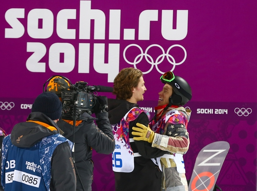 Feb 11, 2014; Krasnaya Polyana, RUSSIA; Iouri Podladtchikov (SUI) (26) receives a hug from Shaun White (USA) right, after winning the gold medal in the mens snowboard half pipe final during the Sochi 2014 Olympic Winter Games at Rosa Khutor Extreme Park. Mandatory Credit: Guy Rhodes-USA TODAY Sports