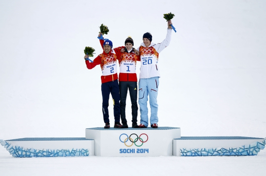 Feb 12, 2014; Krasnaya Polyana, RUSSIA; Akito Watabe (JPN, 2) and Eric Frenzel (GER, 1) and Magnus Krog (NOR, 20) at the flower ceremony following the nordic combined competition in the Sochi 2014 Olympic Winter Games at RusSki Gorki Ski Jumping Center.  Mandatory Credit: Rob Schumacher-USA TODAY Sports