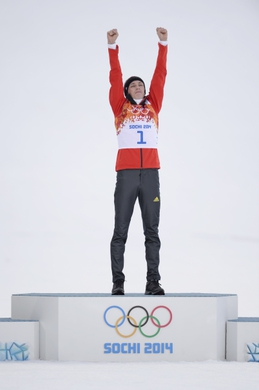 Feb 12, 2014; Krasnaya Polyana, RUSSIA; Eric Frenzel (GER) celebrates at the flower ceremony after the nordic combined competition in the Sochi 2014 Olympic Winter Games at RusSki Gorki Ski Jumping Center. Mandatory Credit: Jack Gruber-USA TODAY Sports