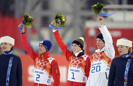 Feb 12, 2014; Krasnaya Polyana, RUSSIA; Akito Watabe (JPN, 2) and Eric Frenzel (GER, 1) and Magnus Krog (NOR, 20) at the flower ceremony following the nordic combined competition in the Sochi 2014 Olympic Winter Games at RusSki Gorki Ski Jumping Center. Mandatory Credit: Jack Gruber-USA TODAY Sports