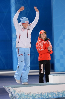 Feb 12, 2014; Sochi, RUSSIA; Tora Berger (NOR) is introduced during the medal ceremony for the biathlon women's 10km pursuit during the Sochi 2014 Olympic Winter Games at the Medals Plaza. Mandatory Credit: James Lang-USA TODAY Sports