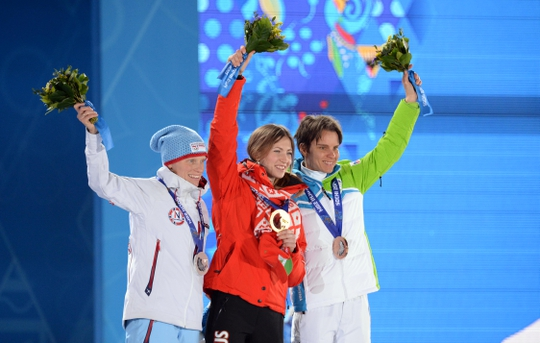 Feb 12, 2014; Sochi, RUSSIA; Darya Domracheva (BLR), middle, Tora Berger (NOR), left, and Teja Gregorin (SLO) pose with their medals during the medal ceremony for the biathlon women's 10km pursuit during the Sochi 2014 Olympic Winter Games at the Medals Plaza. Mandatory Credit: James Lang-USA TODAY Sports