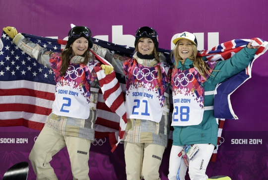 Feb 12, 2014; Krasnaya Polyana, RUSSIA; Kaitlyn Farrington (USA, center) wins gold, Torah Bright (AUS, right) wins silver, and Kelly Clark (USA, center) wins bronze in the ladies' half pipe finals during the Sochi 2014 Olympic Winter Games at Rosa Khutor Extreme Park. Mandatory Credit: Andrew P. Scott-USA TODAY Sports