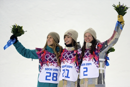 Feb 12, 2014; Krasnaya Polyana, RUSSIA; Kaitlyn Farrington (USA, center) wins gold, Torah Bright (AUS, left) wins silver, and Kelly Clark (USA, right) wins bronze in the ladies' half pipe finals during the Sochi 2014 Olympic Winter Games at Rosa Khutor Extreme Park. Mandatory Credit: Andrew P. Scott-USA TODAY Sports