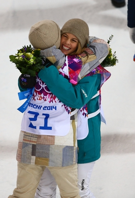 Feb 12, 2014; Krasnaya Polyana, RUSSIA; Kaitlyn Farrington (USA) (left) receives a hug from Torah Bright (AUS) after winning the gold medal in the ladies snowboard halfpipe during the Sochi 2014 Olympic Winter Games at Rosa Khutor Extreme Park. Mandatory Credit: Guy Rhodes-USA TODAY Sports