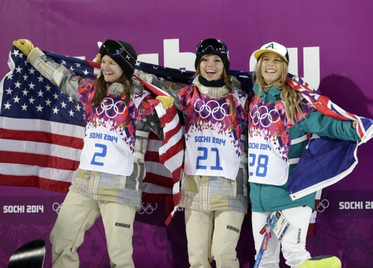 Feb 12, 2014; Krasnaya Polyana, RUSSIA; Kaitlyn Farrington (USA, center) wins gold, Torah Bright (AUS, right) wins silver, and Kelly Clark (USA, left) wins bronze in the ladies' half pipe finals during the Sochi 2014 Olympic Winter Games at Rosa Khutor Extreme Park. Mandatory Credit: Andrew P. Scott-USA TODAY Sports