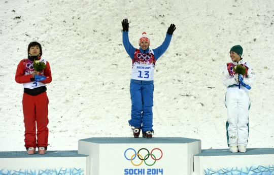 Feb 14, 2014; Krasnaya Polyana, RUSSIA; Alla Tsuper (BLR, 13) wins gold, Mengtao Xu (CHN, 3) wins silver, and Lydia Lassila (AUS, 4) wins bronze in the ladies' freestyle skiing aerials finals during the Sochi 2014 Olympic Winter Games at Rosa Khutor Extreme Park. Mandatory Credit: Jack Gruber-USA TODAY Sports