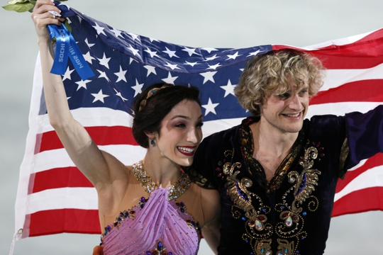 Feb 17, 2014; Sochi, RUSSIA; Charlie White and Meryl Davis (USA) celebrate winning the gold medal in ice dance free dance program during the Sochi 2014 Olympic Winter Games at Iceberg Skating Palace.  Mandatory Credit: Jeff Swinger-USA TODAY Sports