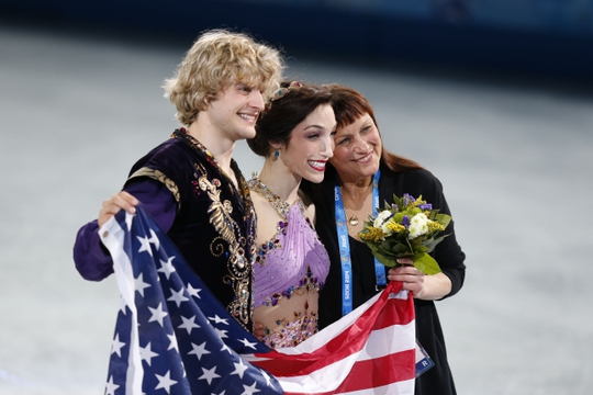 Feb 17, 2014; Sochi, RUSSIA; Charlie White and Meryl Davis (USA) celebrate winning the gold medal in ice dance free dance program with their coach Marina Zueva during the Sochi 2014 Olympic Winter Games at Iceberg Skating Palace.  Mandatory Credit: Jeff Swinger-USA TODAY Sports