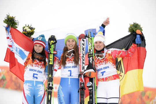 Feb 18, 2014; Krasnaya Polyana, RUSSIA; Tina Maze (SLO, 1) wins gold, Anna Fenninger (AUT, 5) wins silver, and Viktoria Rebensburg (GER, 7) wins bronze ladies' giant slalom during the Sochi 2014 Olympic Winter Games at Rosa Khutor Alpine Center. Mandatory Credit: Jack Gruber-USA TODAY Sports