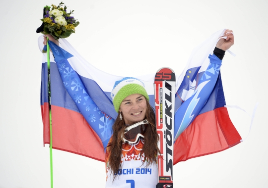 Feb 18, 2014; Krasnaya Polyana, RUSSIA; Tina Maze (SLO) celebrates winning gold in ladies' giant slalom during the Sochi 2014 Olympic Winter Games at Rosa Khutor Alpine Center. Mandatory Credit: Jack Gruber-USA TODAY Sports