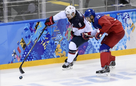 Feb 19, 2014; Sochi, RUSSIA; USA forward Zach Parise (9) reaches for the puck against Czech Republic defenseman Michal Rozsival (32) in the men's ice hockey quarterfinals during the Sochi 2014 Olympic Winter Games at Shayba Arena. Mandatory Credit: Scott Rovak-USA TODAY Sports