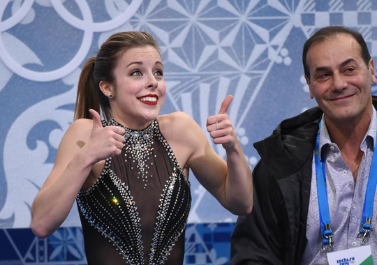 Feb 19, 2014; Sochi, RUSSIA; Ashley Wagner of the USA and her coach Rafael Arutunian as she receives her score for her performance in the ladies short program during the Sochi 2014 Olympic Winter Games at Iceberg Skating Palace. Mandatory Credit: Robert Deutsch-USA TODAY Sports