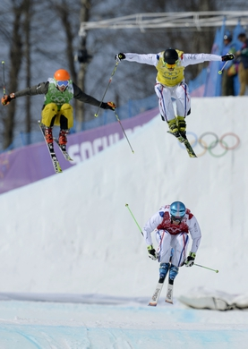 Feb 20, 2014; Krasnaya Polyana, RUSSIA; Jean Frederic Chapuis (FRA, red) leads the field in 1/8 finals for men's ski cross during the Sochi 2014 Olympic Winter Games at Rosa Khutor Extreme Park. Mandatory Credit: Jack Gruber-USA TODAY Sports