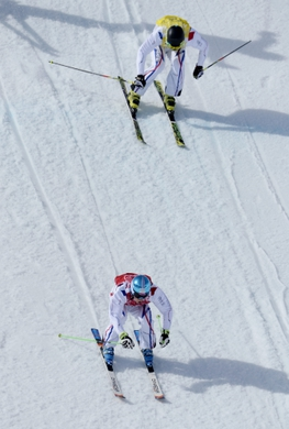 Feb 20, 2014; Krasnaya Polyana, RUSSIA; Jean Frederic Chapuis (FRA, red) ahead of Jonathan Midol (FRA, yellow) in semifinals for men's ski cross during the Sochi 2014 Olympic Winter Games at Rosa Khutor Extreme Park. Mandatory Credit: Jack Gruber-USA TODAY Sports
