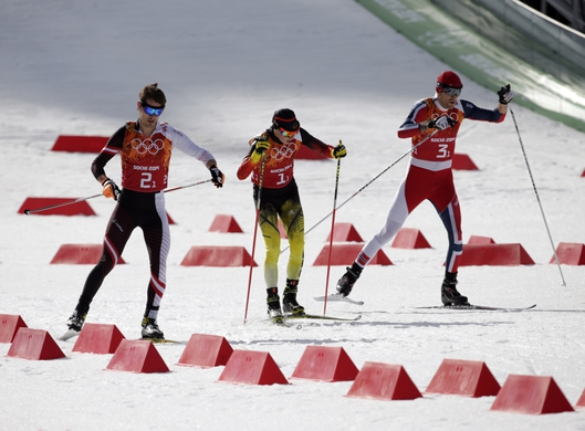 Feb 20, 2014; Krasnaya Polyana, RUSSIA; Lukas Klapfer (AUT, left), Eric Frenzel (GER, center) and Magnus Hovdal Moan (NOR, right) compete in nordic combined team gundersen LH / 4x5 km during the Sochi 2014 Olympic Winter Games at RusSki Gorki Ski Jumping Center. Mandatory Credit: Andrew P. Scott-USA TODAY Sports