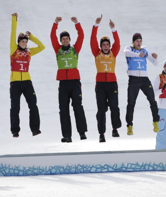 Feb 20, 2014; Krasnaya Polyana, RUSSIA;  Eric Frenzel (red), Bjoern Kircheisen (green), Johannes Rydzek (orange), and Fabian Riessle (blue) win silver in nordic combined team gundersen LH / 4x5 km during the Sochi 2014 Olympic Winter Games at RusSki Gorki Ski Jumping Center. Mandatory Credit: Andrew P. Scott-USA TODAY Sports