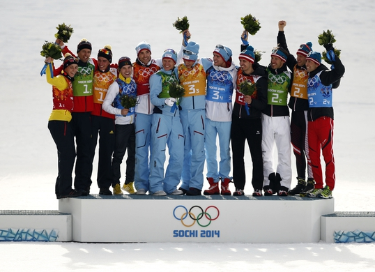 Feb 20, 2014; Krasnaya Polyana, RUSSIA; (From left to right) Eric Frenzel (GER), Bjoern Kircheisen (GER), Johannes Rydzek (GER), and Fabian Riessle (GER) win silver, Magnus Hovdal Moan (NOR), Haavard Klemetsen (NOR), Magnus Krog (NOR), and Joergen Graabak (NOR) win gold, and Lukas Klapfer (AUT), Christoph Bieler (AUT), Bernhard Gruber (AUT), and Mario Stecher (AUT) win bronze in nordic combined team gundersen LH / 4x5 km during the Sochi 2014 Olympic Winter Games at RusSki Gorki Ski Jumping Center. Mandatory Credit: Rob Schumacher-USA TODAY Sports
