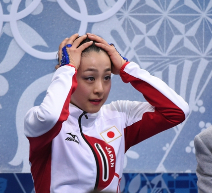 Feb 20, 2014; Sochi, RUSSIA; Mao Asada of Japan reacts to her scores in the ladies free skate program during the Sochi 2014 Olympic Winter Games at Iceberg Skating Palace. Mandatory Credit: Robert Deutsch-USA TODAY Sports
