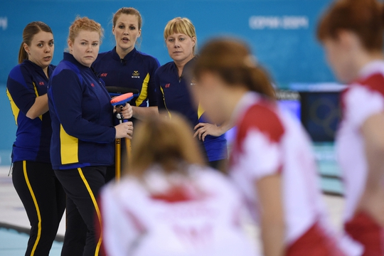 Feb 20, 2014; Sochi, RUSSIA; (L-R) Maria Wennerstroem (SWE), Margaretha Sigfridsson (SWE), Christina Bertrup (SWE), Maria Prytz (SWE) watch as Canada discuss in the women's curling gold medal match during the Sochi 2014 Olympic Winter Games at Ice Cube Curling Center. Mandatory Credit: Kyle Terada-USA TODAY Sports