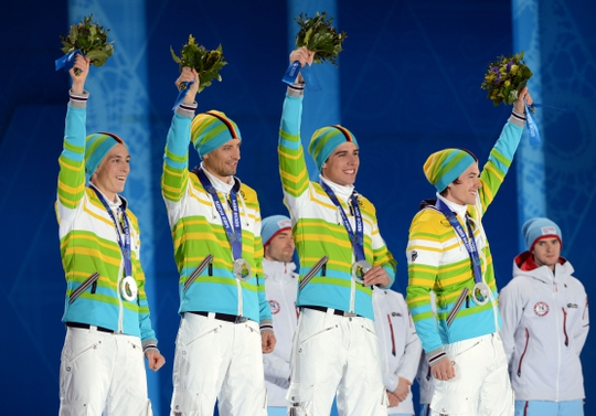 Feb 20, 2014; Sochi, RUSSIA; (Left to right) Eric Frenzel, Bjoern Kircheisen, Johannes Rydzek, and Fabian Riessle, all of Germany react after receiving their silver medals during the medal ceremony for Nordic Combined Team Gundersen 4x5km during the Sochi 2014 Olympic Winter Games at the Medals Plaza. Mandatory Credit: Jayne Kamin-Oncea-USA TODAY Sports