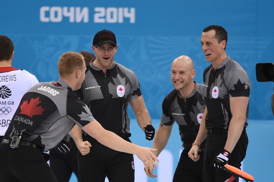 Feb 21, 2014; Sochi, RUSSIA; (L-R) Brad Jacobs (CAN), Ryan Harnden (CAN), Ryan Fry (CAN), and E.J. Harnden (CAN) celebrate after winning the gold medal in the men's curling gold medal match during the Sochi 2014 Olympic Winter Games at Ice Cube Curling Center. Mandatory Credit: Kyle Terada-USA TODAY Sports