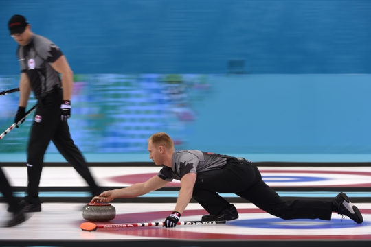 Feb 21, 2014; Sochi, RUSSIA; Ryan Harnden (CAN) and Brad Jacobs (CAN) in the men's curling gold medal match during the Sochi 2014 Olympic Winter Games at Ice Cube Curling Center. Mandatory Credit: Kyle Terada-USA TODAY Sports
