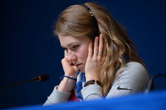 Feb 22, 2014; Sochi, RUSSIA; Gold medalist Mikaela Shiffrin (USA) listens to a translation of a reporter's question at a press conference for the women's slalom at the Sochi 2014 Olympic Winter Games. Mandatory Credit: Jayne Kamin-Oncea-USA TODAY Sports