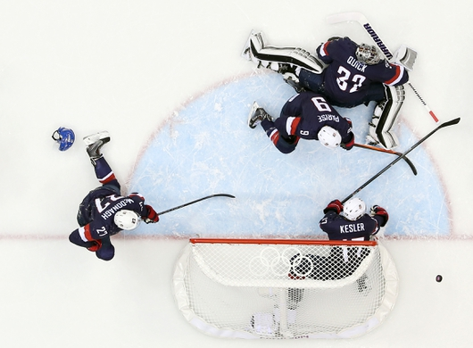 Feb 22, 2014; Sochi, RUSSIA; USA players Ryan McDonagh (27) , Ryan Kesler (17) , Zach Parise (9) and Jonathan Quick (32) defend the net against Finland in the men's ice hockey bronze medal game during the Sochi 2014 Olympic Winter Games at Bolshoy Ice Dome. Mandatory Credit: Winslow Townson-USA TODAY Sports
