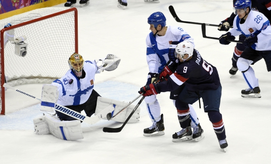 Feb 22, 2014; Sochi, RUSSIA; Finland goalie Tuukka Rask (40) makes a save as defenseman Sami Salo (6) defends against USA forward Zach Parise (9)  in the men's ice hockey bronze medal game during the Sochi 2014 Olympic Winter Games at Bolshoy Ice Dome. Mandatory Credit: Scott Rovak-USA TODAY Sports