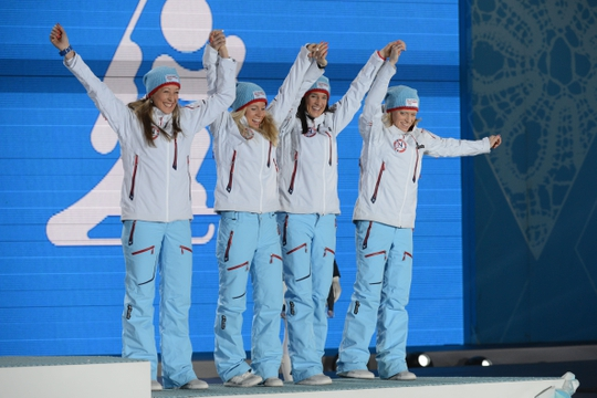 Feb 22, 2014; Sochi, RUSSIA; Fanny Welle-Strand Horn (NOR), Tiril Eckhoff (NOR), Ann Kristin Aafedt Flatland (NOR) and Tora Berger (NOR) celebrate winning the bronze medal in biathlon women   s relay during the Sochi 2014 Olympic Winter Games at the Medals Plaza. Mandatory Credit: Jayne Kamin-Oncea-USA TODAY Sports