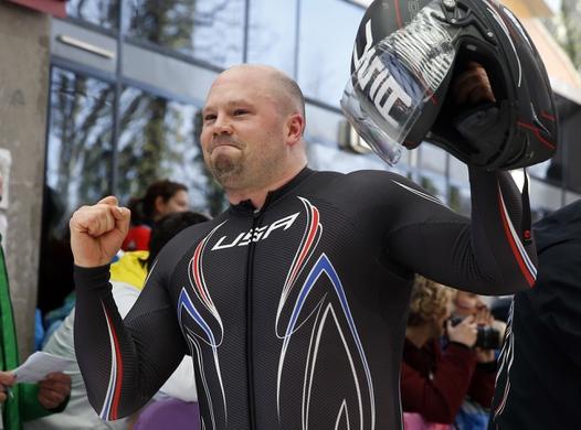 Feb 23, 2014; Krasnaya Polyana, RUSSIA; USA-1 pilot Steven Holcomb reacts after heat 4 of men's four-man bobsleigh during the Sochi 2014 Olympic Winter Games at Sanki Sliding Center. Mandatory Credit: Kevin Jairaj-USA TODAY Sports