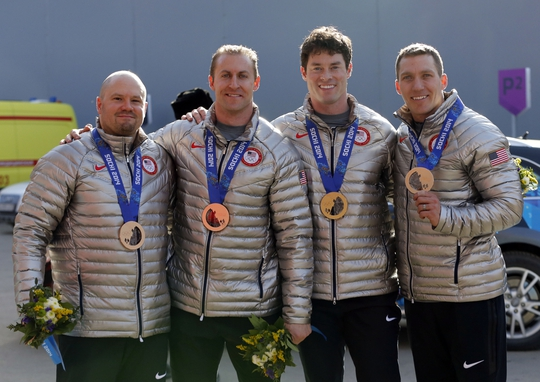 Feb 23, 2014; Krasnaya Polyana, RUSSIA; USA-1 team of Steven Holcomb, Curtis Tomasevicz, Steven Langton, and Christopher Fogt win bronze in men's four-man bobsleigh during the Sochi 2014 Olympic Winter Games at Sanki Sliding Center. Mandatory Credit: Kevin Jairaj-USA TODAY Sports