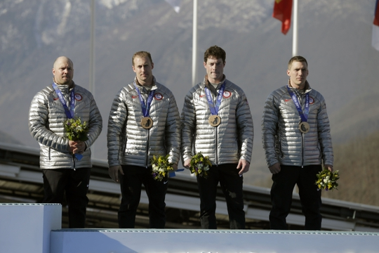 Feb 23, 2014; Krasnaya Polyana, RUSSIA; Team USA 1 piloted by Steven Holcomb and teammates Curtis Tomasvicz, Steven Langton, and Christopher Fogt celebrate their bronze medal win in the 4-man bobsled during the Sochi 2014 Olympic Winter Games at Sanki Sliding Center. Mandatory Credit: Andrew P. Scott-USA TODAY Sports