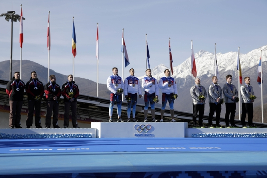 Feb 23, 2014; Krasnaya Polyana, RUSSIA; (From left to right) LAT-1 team of Oskars Melbardis, Daumants Dreiskens, Arvis Vilkaste, and Janis Strenga win silver, RUS-1 team of Alexander Zubkov, Alexey Negodaylo, Dmitry Trunenkov, and Alexey Voevoda win gold, and USA-1 team of Steven Holcomb, Curtis Tomasevicz, Steven Langton, and Christopher Fogt win bronze in four-man bobsleigh during the Sochi 2014 Olympic Winter Games at Sanki Sliding Center. Mandatory Credit: Andrew P. Scott-USA TODAY Sports